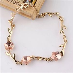 NWT pink crystal flower gold plated bracelet